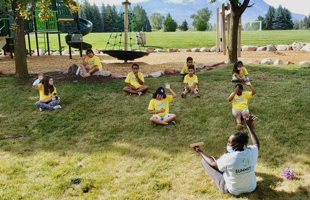 Teacher Nyibol Bior leads her class in Focused Kids brain exercises in Triangle Park in Carbondale last summer. The exercises help kids relax and prepare to learn. | Courtesy photo