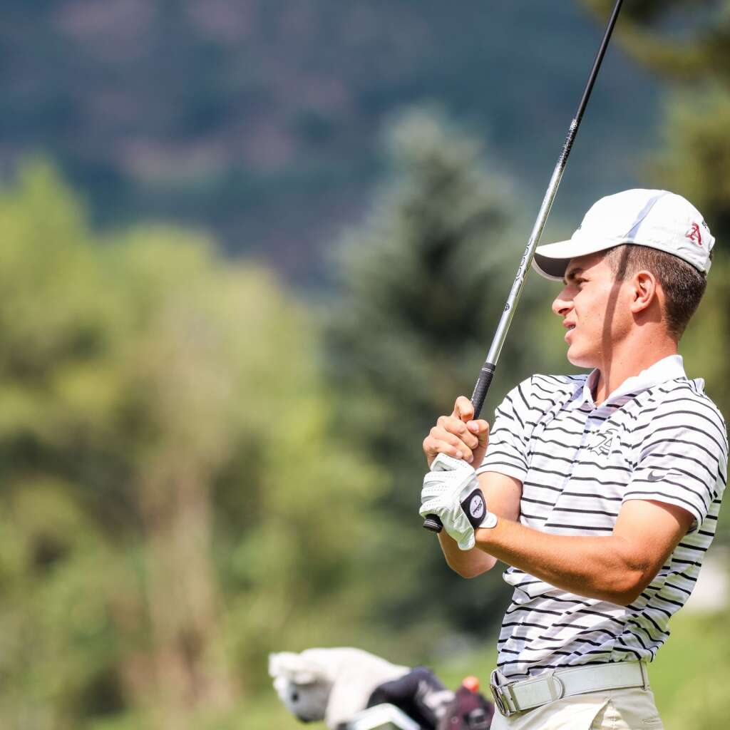 Aspen High School senior Nic Pevny watches the flight of his ball during the Skiers' home golf tournament on Monday, Aug. 16, 2021, at Aspen Golf Club. Photo by Austin Colbert/The Aspen Times.