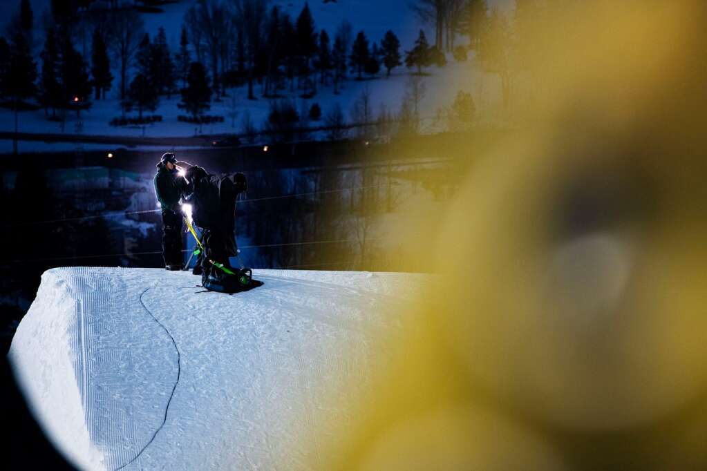 A cameraperson gathers footage as the sun sets of the top of the Big Air course while athletes practice for the 2021 X Games Aspen at Buttermilk on Thursday, Jan. 28, 2021. (Kelsey Brunner/The Aspen Times)