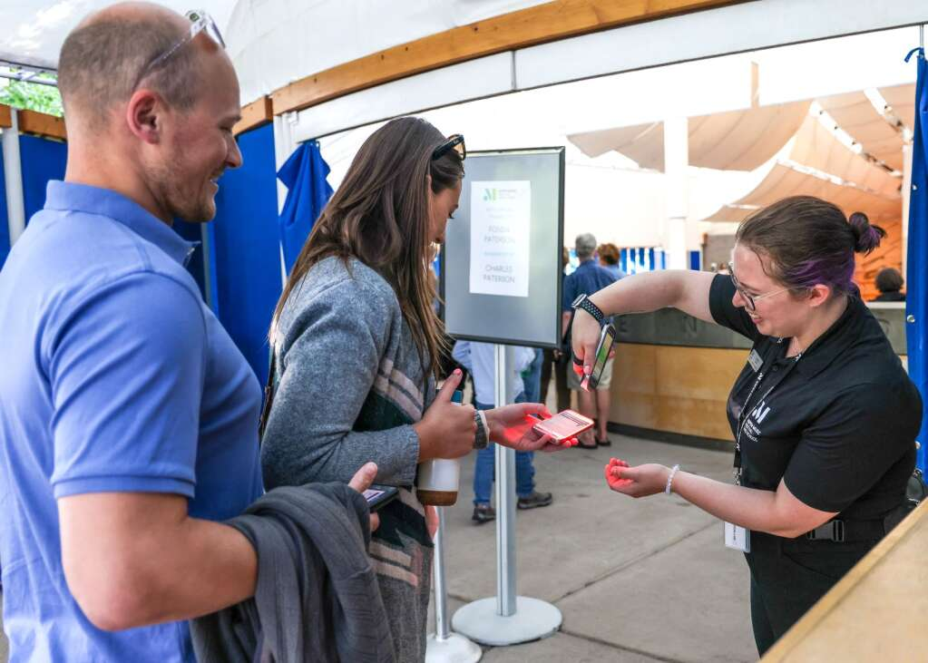 Jessica Everts, right, scans a patron's ticket to watch pianist Matthew Whitaker perform in an Aspen Music Festival and School recital to kickoff the summer season on Thursday, July 1, 2021, inside the Benedict Music Tent in Aspen. Photo by Austin Colbert/The Aspen Times.
