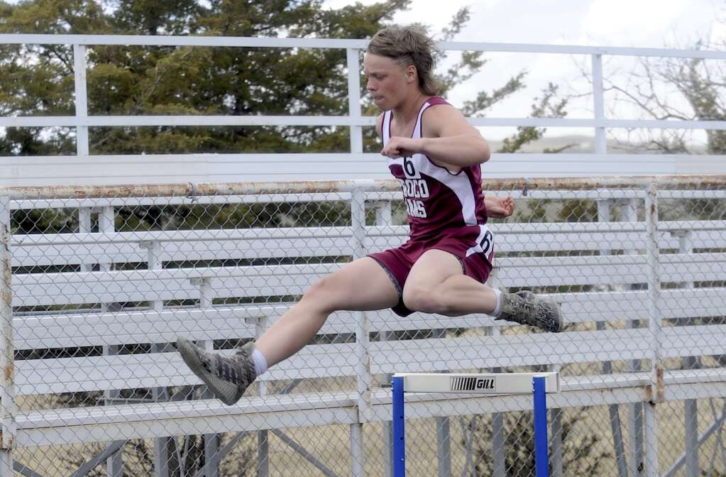 Soroco athlete Gavyn Salberg competes in the 300-meter hurdles at the Clint Wells Invitational in Craig on Friday. (Photo by Shelby Reardon)