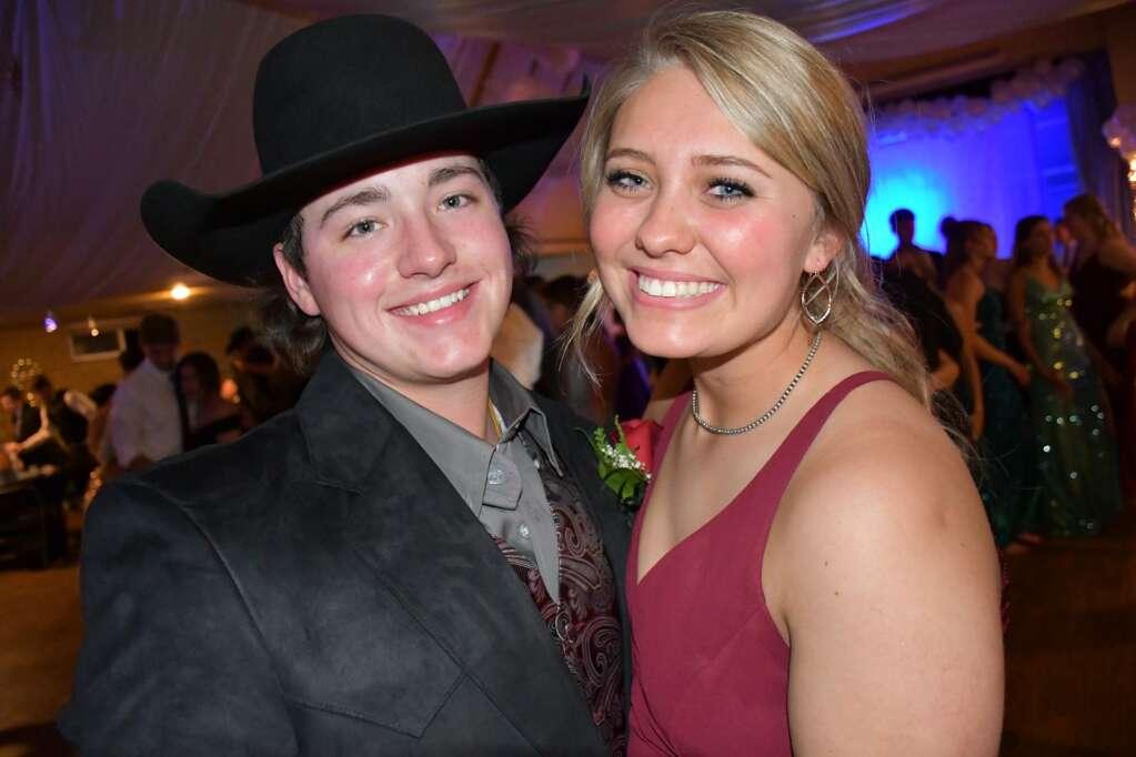 Trinity Bulger shares a moment with her date during prom Saturday. (Andy Bockelman / For Craig Press)