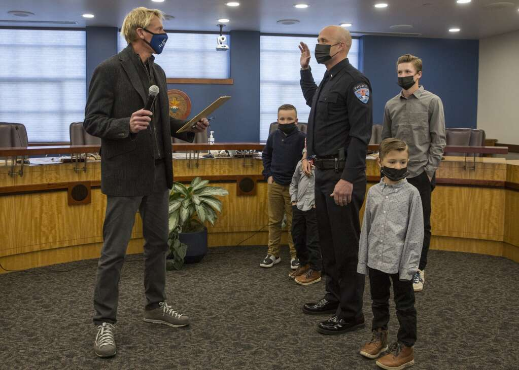Mayor Andy Beerman, left, swears-in Park City Police Lieutenant Robert McKinney during the council meeting Thursday, April 1, 2021, at City Hall. Lt. McKinney was accompanied by his wife Karli and their children Bailey, Blake, Boston, Beckham and Matthew. (Tanzi Propst/Park Record)