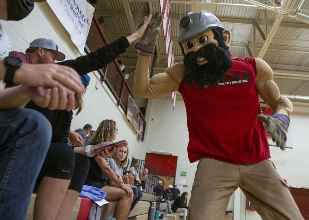 Manny the Miner gives high-fives to Miner volleyball fans during a timeout of the game against East High School Tuesday evening, Sept. 14, 2021. (Tanzi Propst/Park Record)
