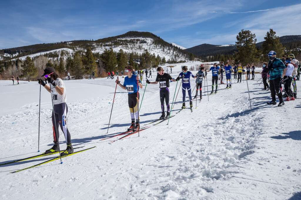 Competitors line up at the start of the 3k boys skate race at the 2021 Colorado Nordic Ski State Championships held at the Gold Run Nordic Center in Breckenridge on Saturday, March 6.  (photo by Liz Copan / Studio Copan)