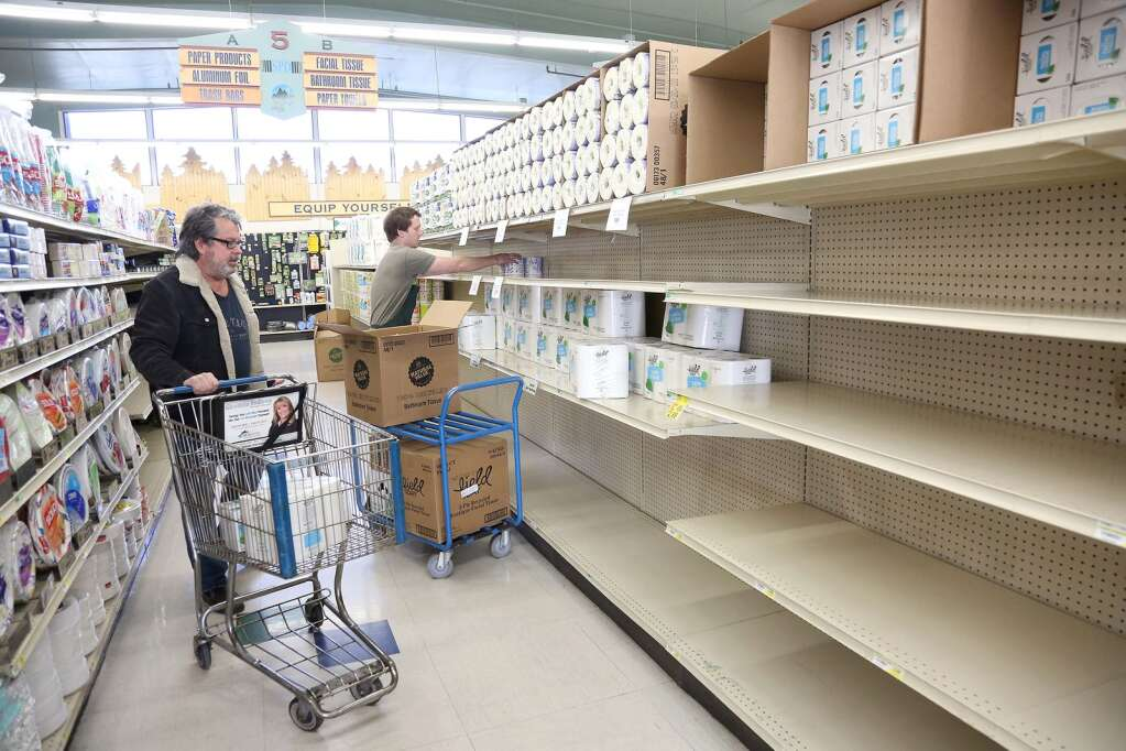 Toilet paper is re-stocked on the shelves at SPD Market in Nevada City. | Photo: Elias Funez