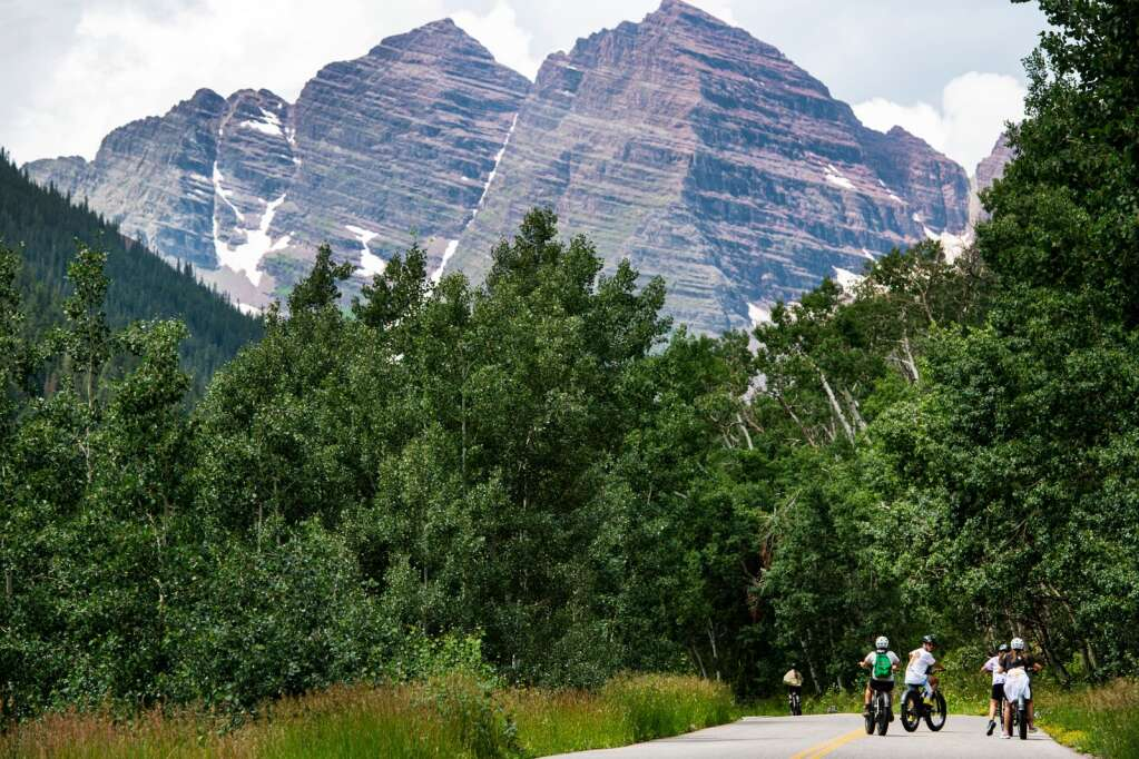 A group of e-bikers stops in the middle of Maroon Creek Road on the way to the Maroon Bells day use area in Aspen on Thursday, July 22, 2021. (Kelsey Brunner/The Aspen Times)
