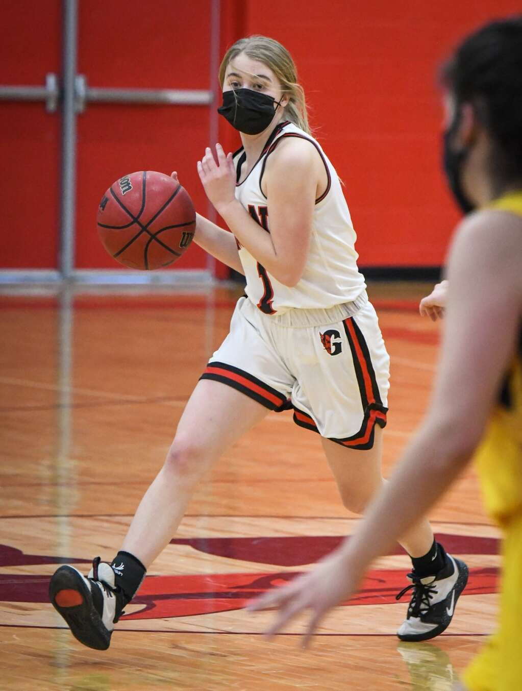 Glenwood Springs Demon Maddie Moser dribbles the ball down the court during Tuesday night's rivalry game against the Rifle Bears. |Chelsea Self / Post Independent