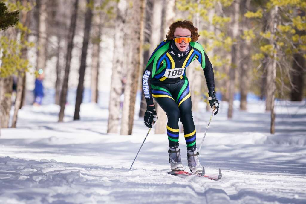Maintaining his corner speed, Liam Goettelman of Summit High nears the finish of the 4.6 kilometer course at Colorado Mountain College in Leadville on Saturday. | Photo by John Hanson
