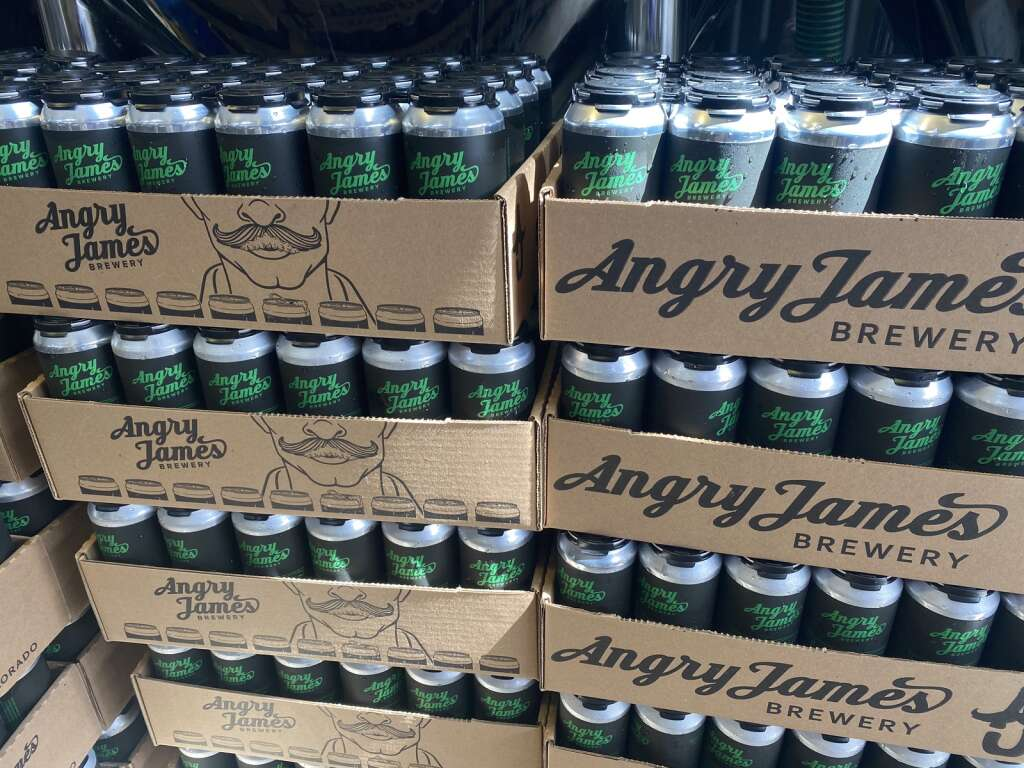 A simple, matte black theme helps Angry James Brewing Co.'s cans stand out while being quick to design. | Photo by Ryan Halsne