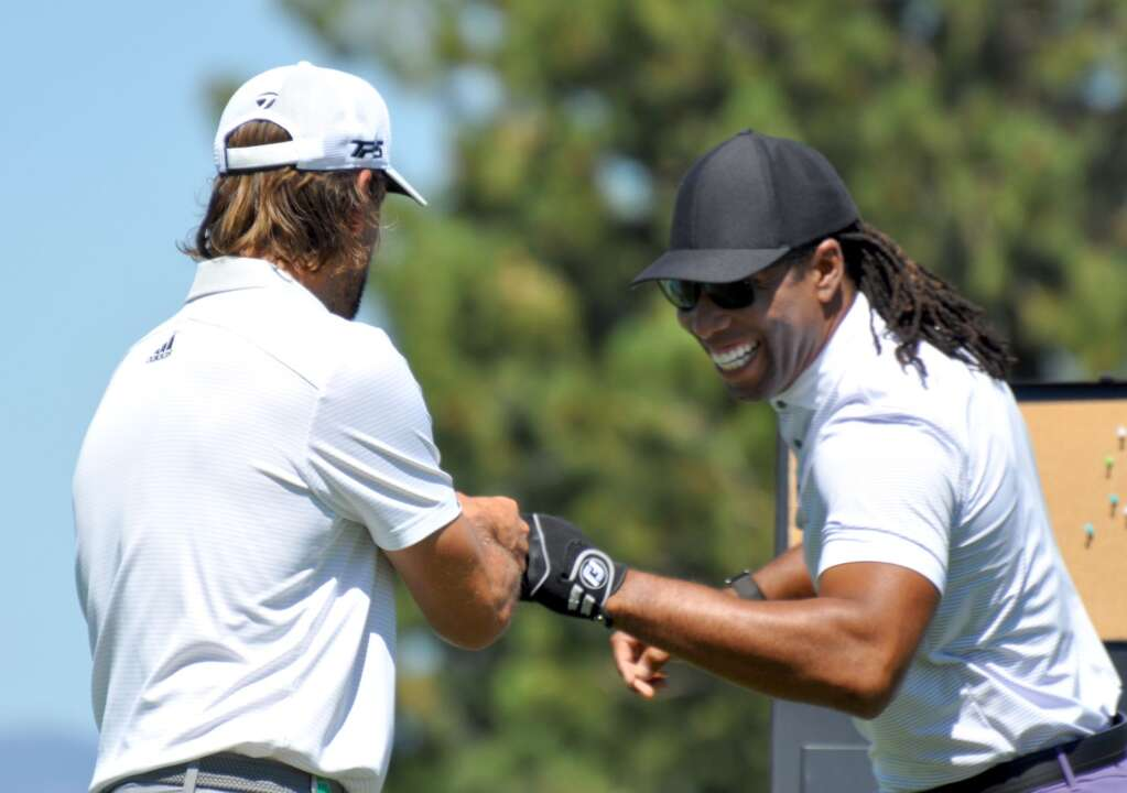 Larry Fitzgerald fist bumps Aaron Rodgers.