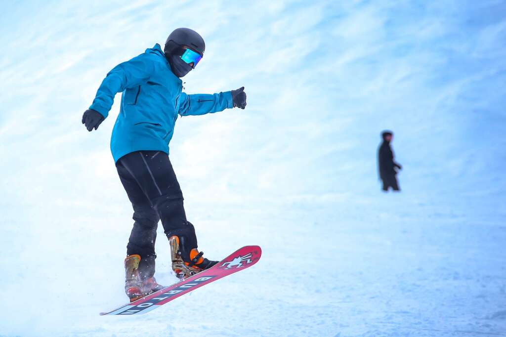 A snowboarder gets some air while making it down Aspen Mountain on Saturday, Jan. 23, 2021. Aspen broke a long dry spell with a little bit of daytime snowfall on Saturday, with more snow expected over the coming days. (Photo by Austin Colbert/The Aspen Times)