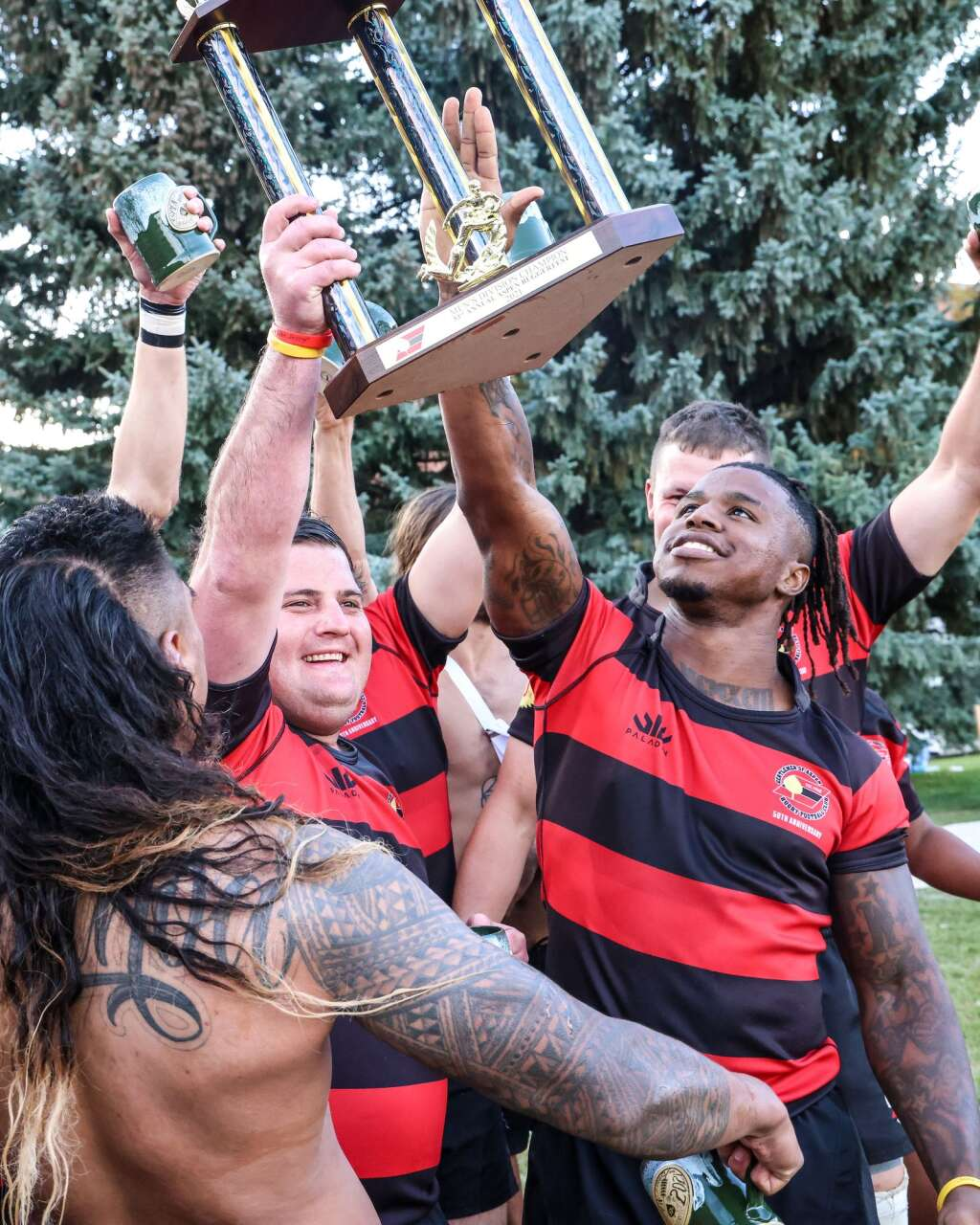 The Gentlemen of Aspen Rugby Club celebrates after beating the American Raptors to win Ruggerfest 53 on Sunday, Sept. 26, 2021, on Wagner Park in downtown Aspen. Photo by Austin Colbert/The Aspen Times.