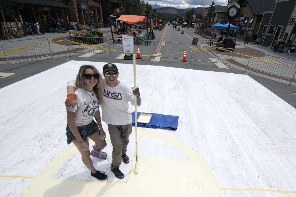 Summit County artists Andy Moran and Erica Rae Dove pose for a portrait on Main Street in Frisco on Thursday, July 1. The two were selected by Make Frisco to create a mural that represents hope and community.