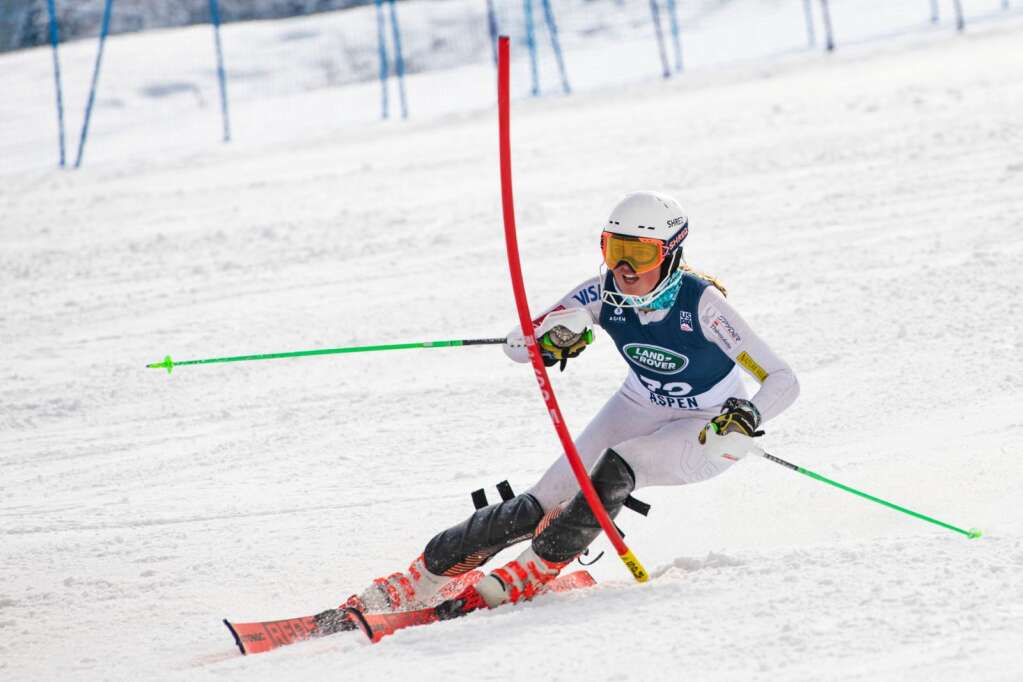 An alpine skier competes in the Women's Slalom National Championships at Aspen Highlands on Friday, April 16, 2021. (Kelsey Brunner/The Aspen Times)
