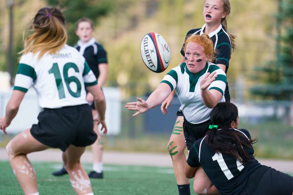 Senior Lily Airey offloads the ball to a teammate during the Green-White scrimmage held at Tiger Stadium in Breckenridge on Thursday, Sept. 2. | John Hanson/For the Summit Daily News