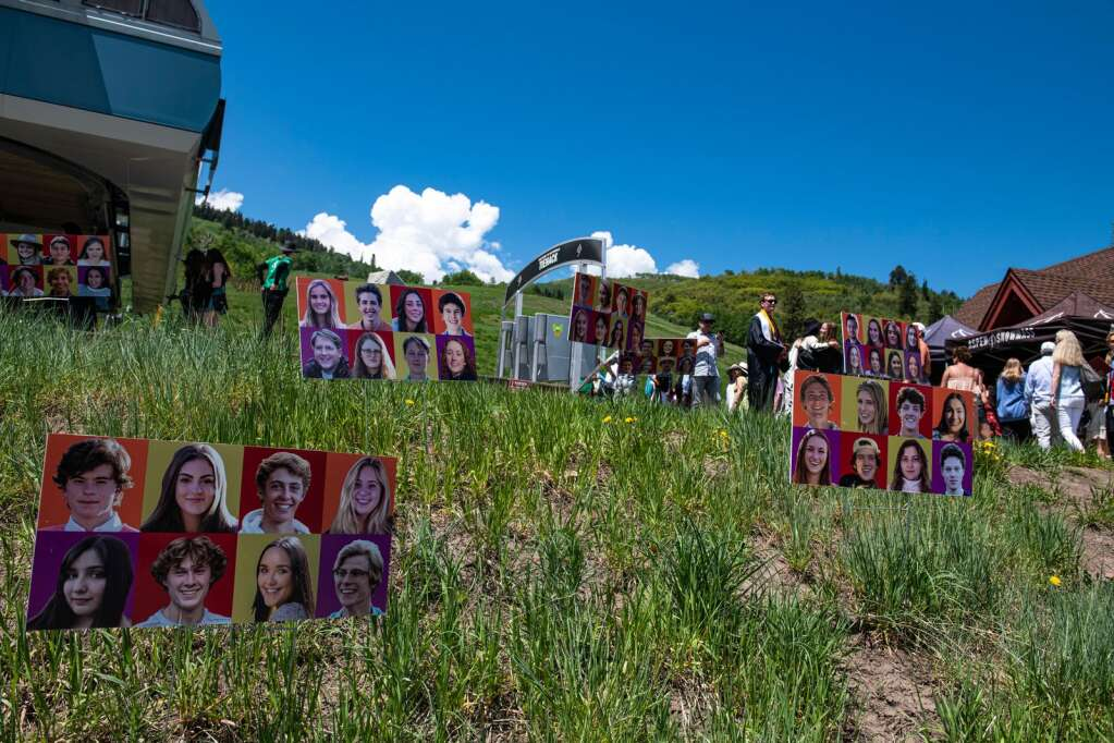 Pictures of the Aspen High School 2021 graduating class decorate the ground beside the Tiehack lift as the graduates load onto the chair lift after their commencement ceremony on Saturday, June 5, 2021. (Kelsey Brunner/The Aspen Times)