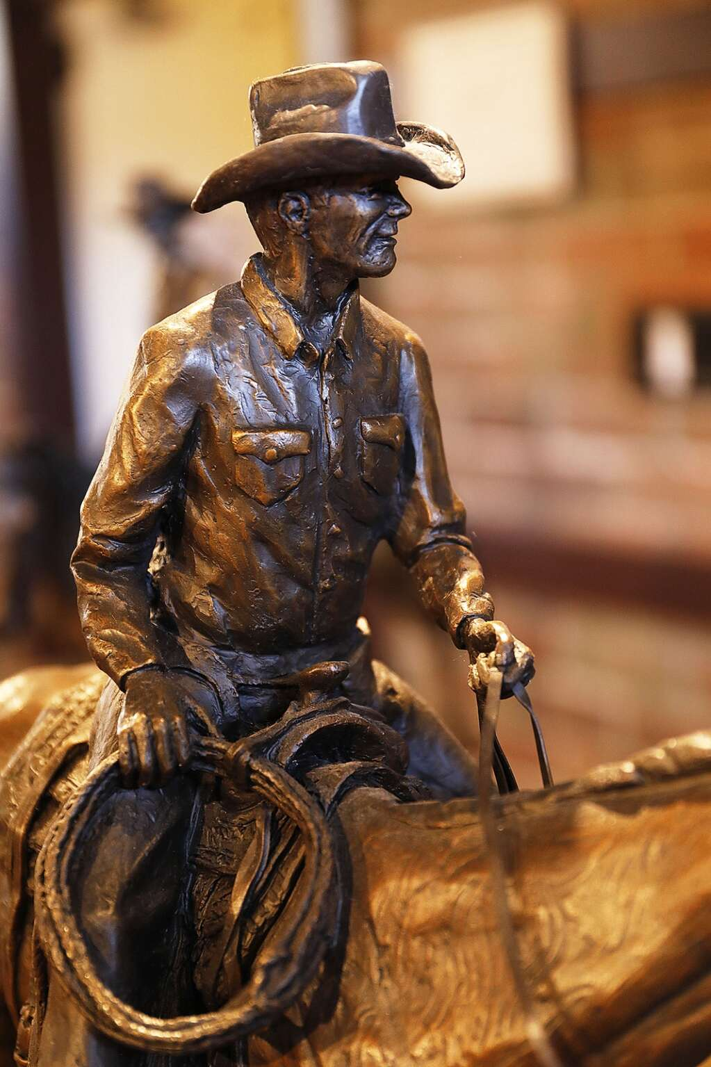 A Curtis Zabel bronze, which will be part of a new exhibit opening at the Depot Art Center for First Friday Artwalk, reflects the artist's love of cowboys and ranching. (Photo by John F. Russell)