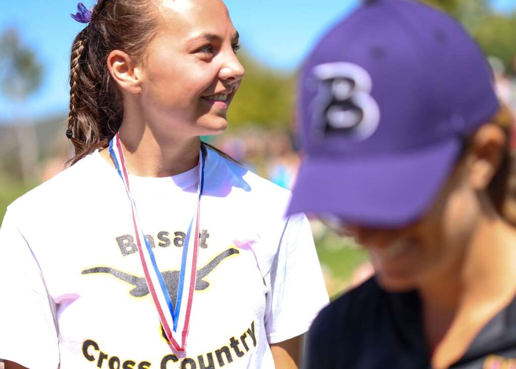 Basalt High School junior Katelyn Maley smiles after receiving her medal for winning the Longhorn Invitational cross country meet on Saturday, Aug. 28, 2021, at Crown Mountain Park in El Jebel. Photo by Austin Colbert/The Aspen Times.