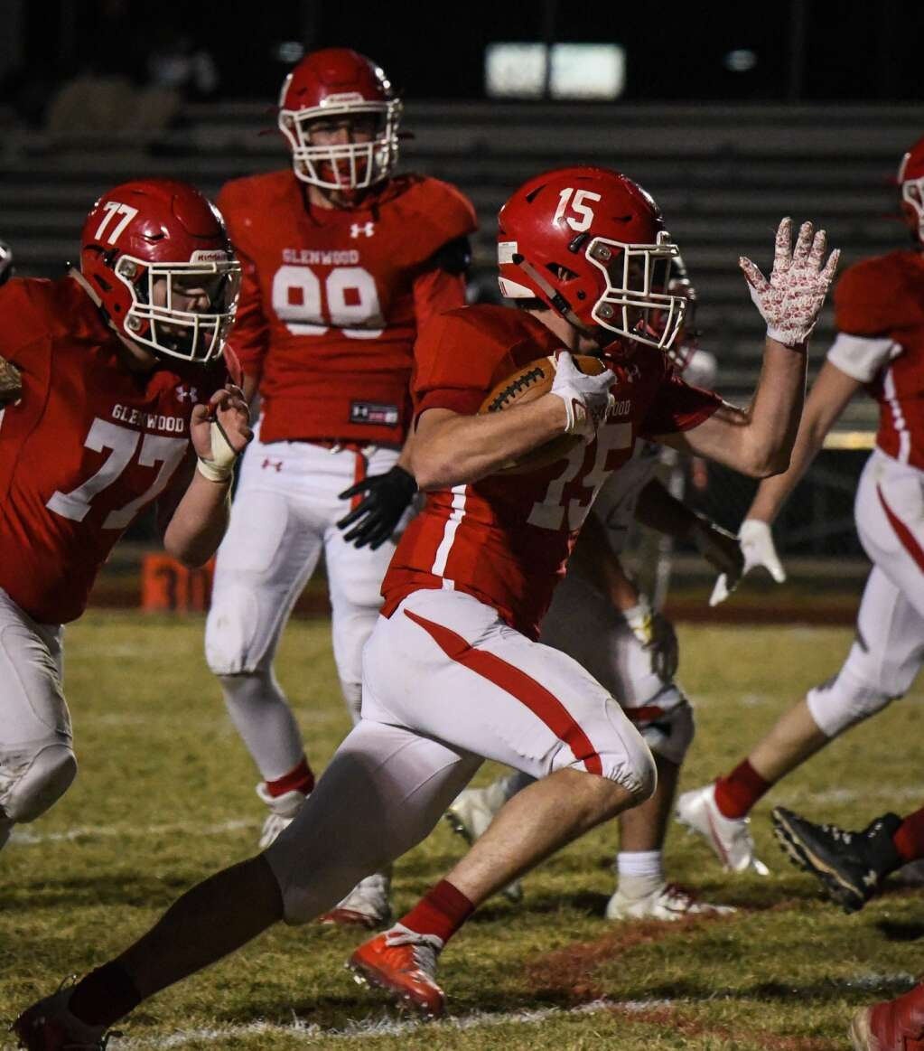 Glenwood Springs Demon Blake Nieslanik runs the ball down the field during Friday night's season opener against the Aspen Skiers. |Chelsea Self / Post Independent