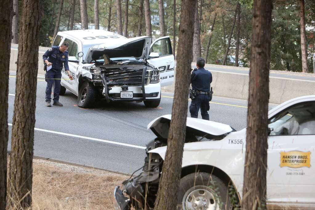 The front end of a Grass Valley Police Department cruiser sits smashed in the southbound Highway 49 lanes near McKnight Way Oct. 8, after a wrong way stolen Hansen Bros. vehicle collided with it. | Photo: Elias Funez