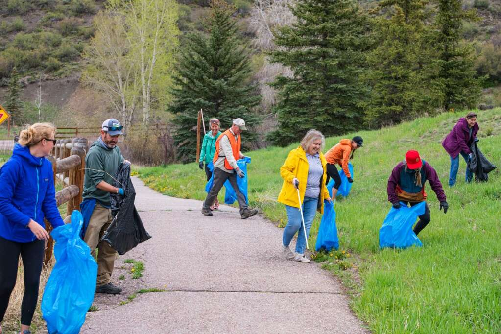 Snowmass Village and Pitkin County employees help clean up the trail bordering Brush Creek Road in Snowmass Village during the annual Town Clean Up Day on Friday, May 21, 2021. (Kelsey Brunner/The Snowmass Sun)