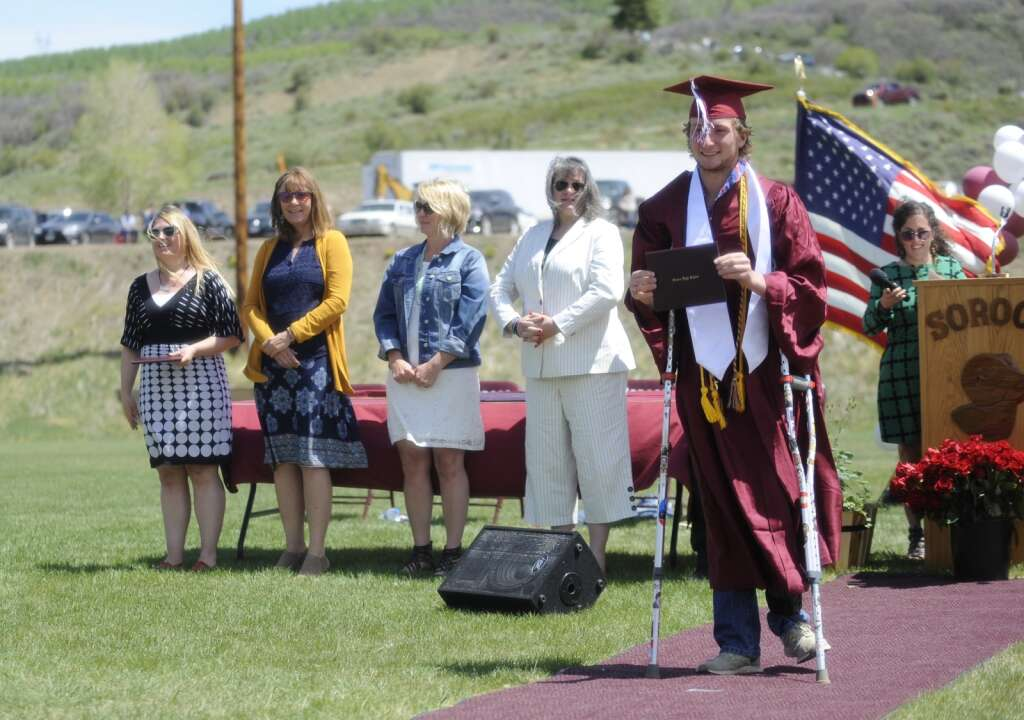 Alex Colby poses with his diploma during the Soroco High School graduation ceremony on Saturday morning.