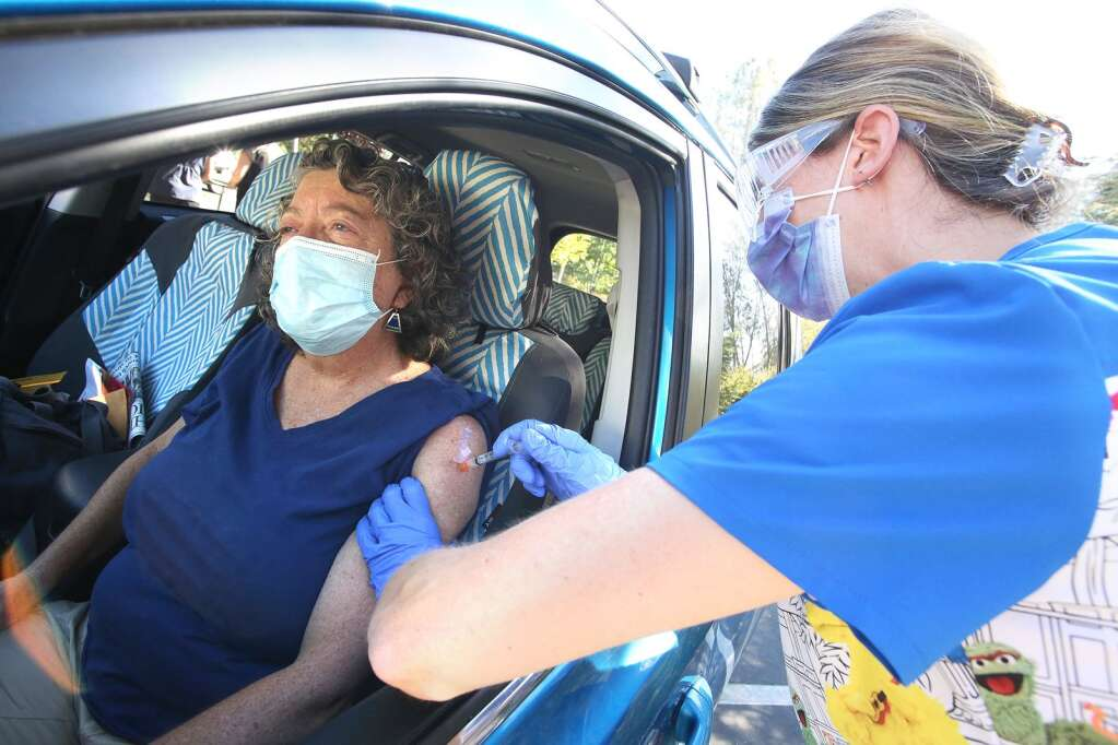 Nevada City's Diane Cross gets her free drive-thru flu shot with the help of nurse Elise Zink Oct. 20 at Chapa-De Indian Health clinic in Grass Valley. | Photo: Elias Funez