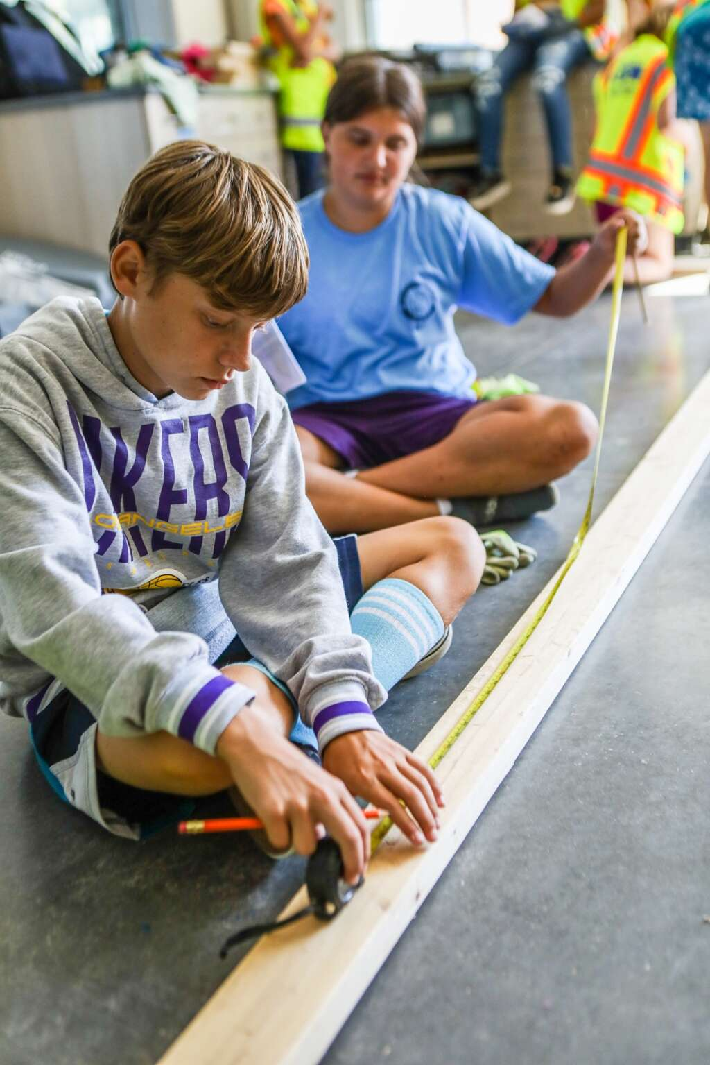 Zeppelin Corr and McKinley DeBellevue measure twice to only cut once during YouthPower365 build day Friday at Eagle Valley Elementary School in Eagle.