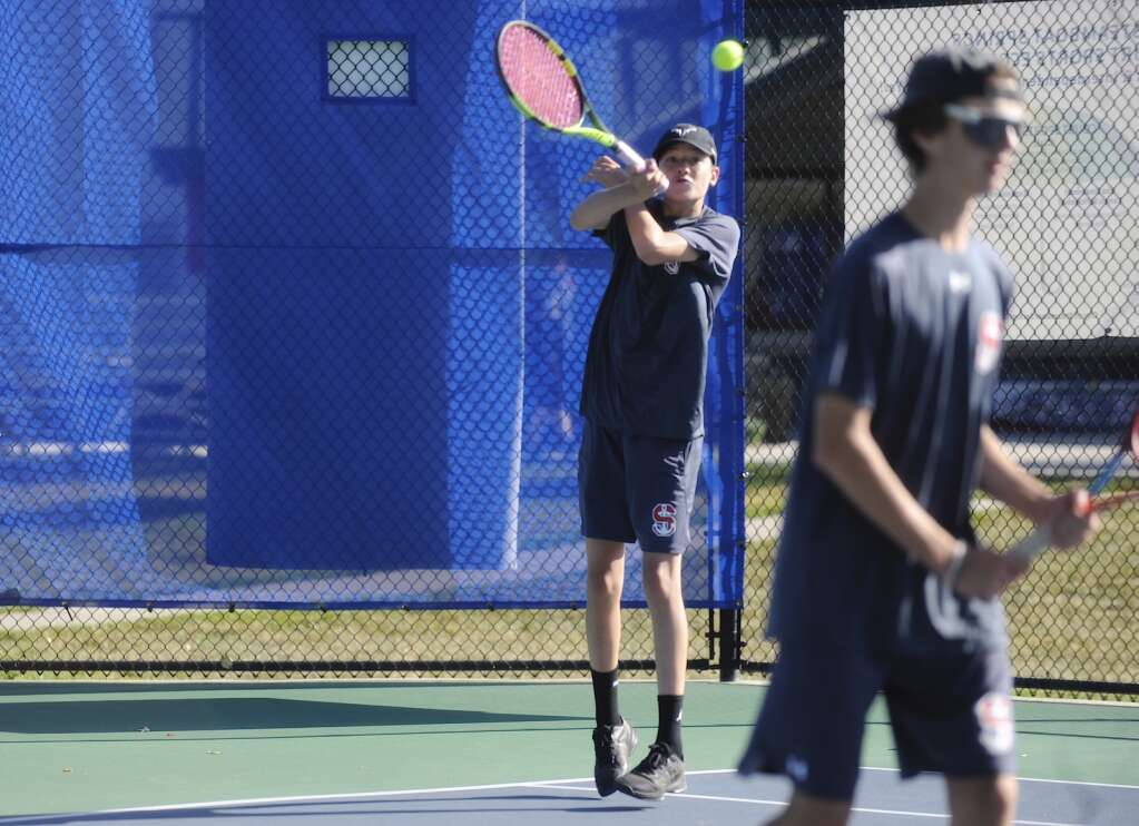 Steamboat Springs boys tennis player Caleb Groemmeck competes in the No. 3 doubles match alongside Eli Ince during a home competition against Rocky Mountain High School on Saturday morning. | Shelby Reardon/Steamboat Pilot & Today