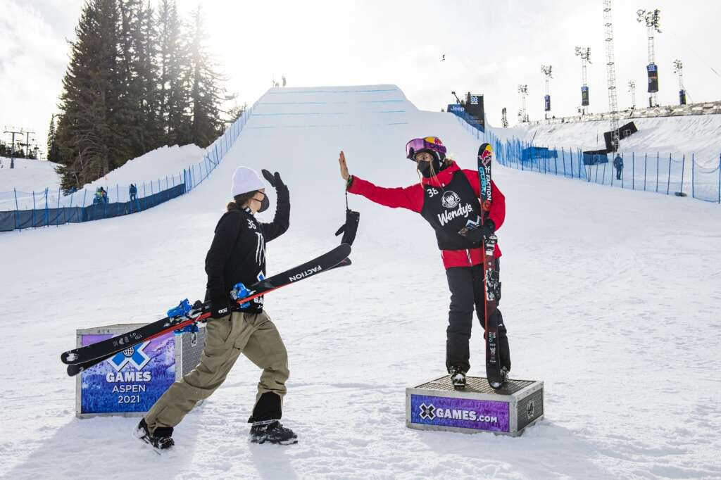 Swiss freestyle skier Mathilde Gremaud high-fives Eileen Gu on the podium after successfully completing a switch double cork 1440 1440 during the Big Air competition that won her the gold medal at the 2021 X Games Aspen at Buttermilk on Friday, Jan. 29, 2021. Gremaud landed the first switch double cork 1440 in history during a womens big air competition. (Kelsey Brunner/The Aspen Times)