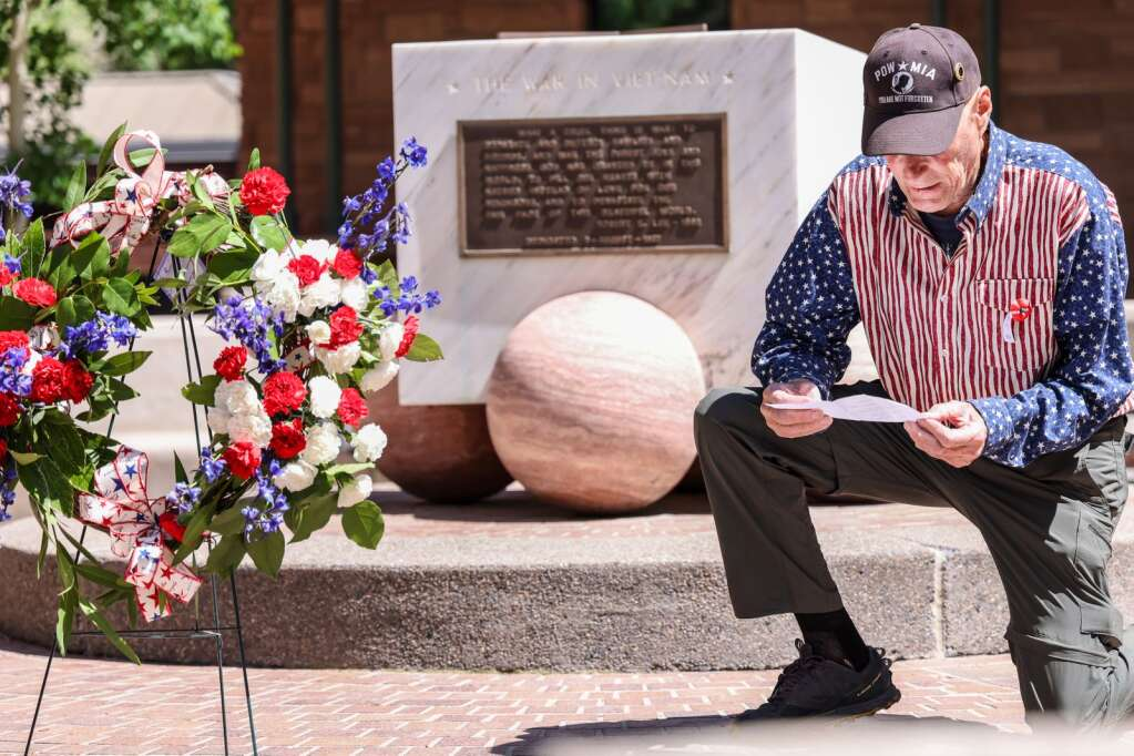 Veteran Dan Glidden reads the names of Roaring Fork Valley locals who died in combat during the annual Memorial Day ceremony on Monday, May 31, 2021, at Pitkin County Veterans Memorial Park in Aspen. Photo by Austin Colbert/The Aspen Times.