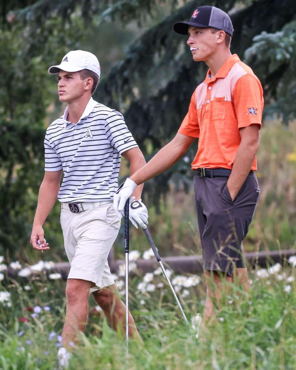Aspen High School senior Nic Pevny, left, stands with Montezuma's Thayer Plewe as they both watch a competitor's ball during the Skiers' home golf tournament on Monday, Aug. 16, 2021, at Aspen Golf Club. Photo by Austin Colbert/The Aspen Times.