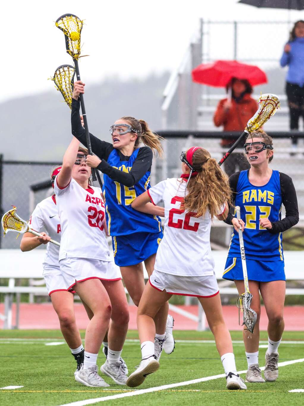 Roaring Fork lacrosse player Riley Dolan, wearing No. 15, rises up to possess the ball against Aspen on Monday, May 17, 2021, on the AHS turf. Photo by Austin Colbert/The Aspen Times.