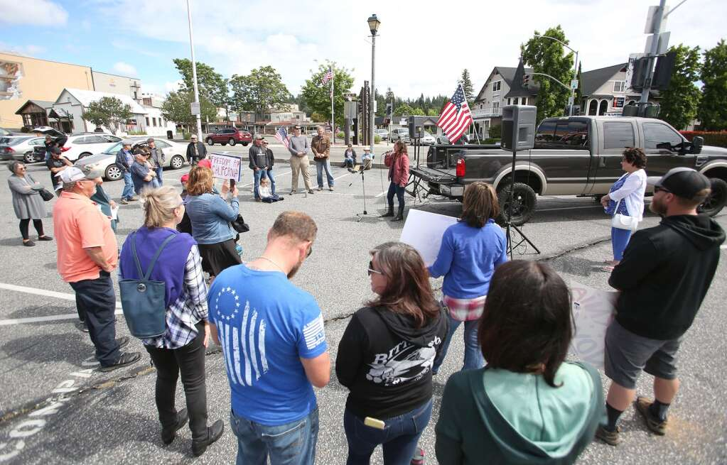 Protesters gathered Saturday morning at corner of Neal and South Auburn Street, to object to the cancelling of the Nevada County Fair and the shuttering of other remaining businesses that have yet to be allowed to re-open June 13. | Photo: Elias Funez