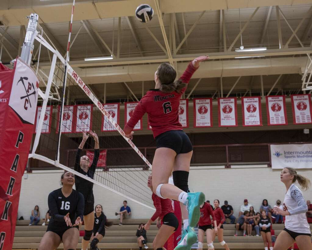 Park City High School senior Siena Volmer (6) spikes the ball over the net during the Miners' matchup against Highland High School Tuesday evening, Sept. 7, 2021. The Miners swept the Rams 3-0. (Tanzi Propst/Park Record)