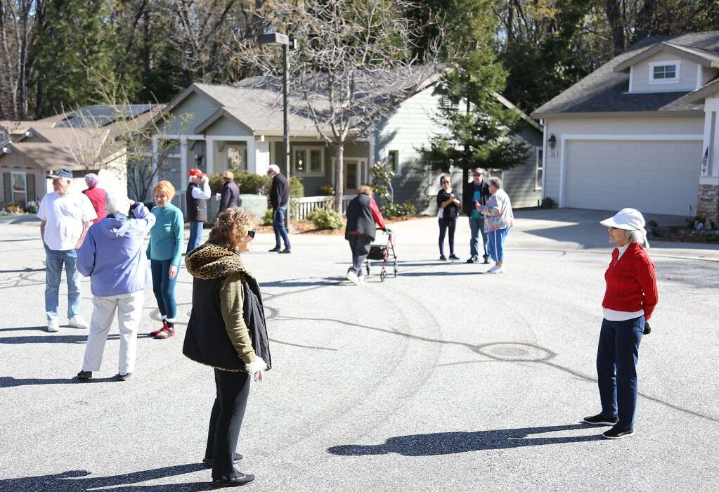 Sparrow Circle residents have been making a morning tradition of greeting each other from a distance during their walks and checking on those at their homes when possible April 7. | Photo: Elias Funez