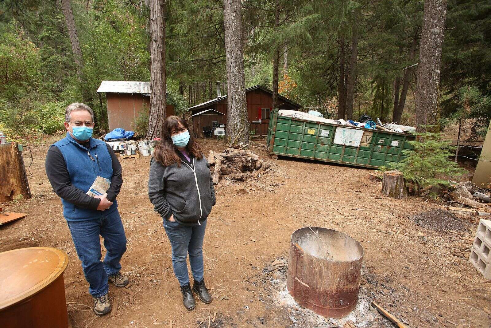 Lisa Marlowe and her husband Bob stand on their family property that was recently overrun by squatters. With extensive help from friends, the property is beginning to look like home again.   Photo: Elias Funez