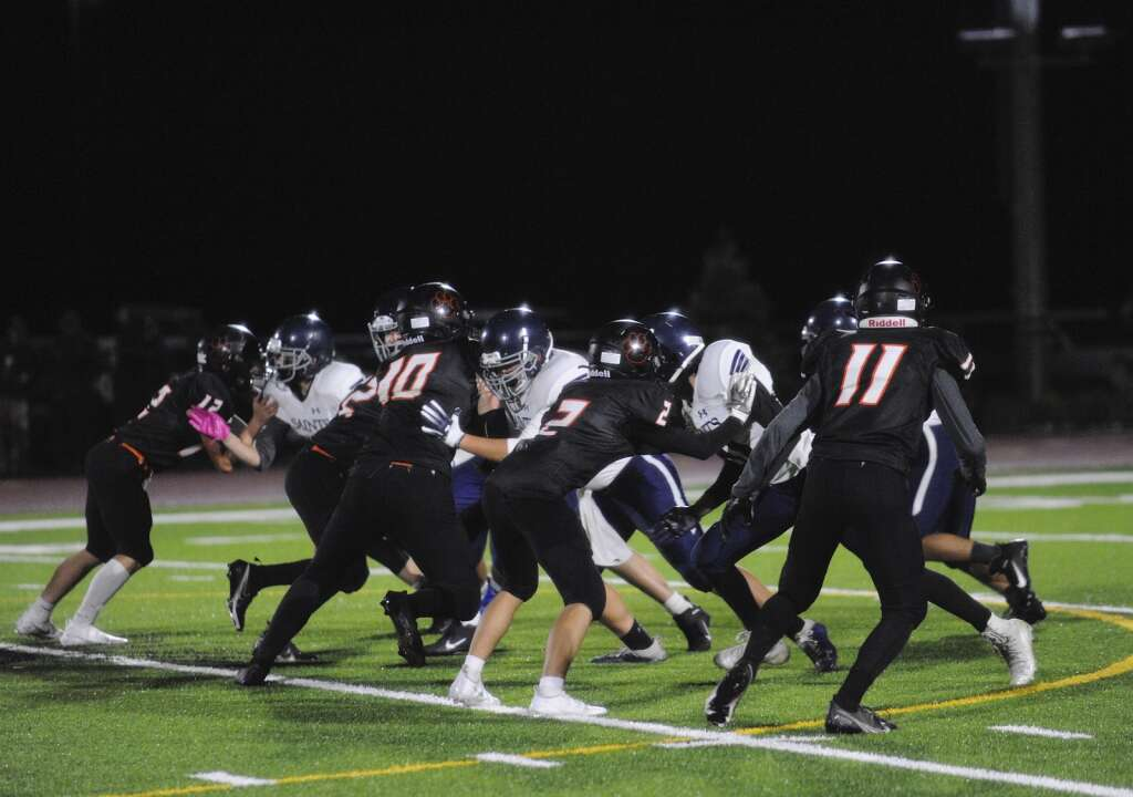 The defensive line on the Hayden football team was busy during a game against Vail Christian at home on Friday.   Shelby Reardon/Steamboat Pilot & Today