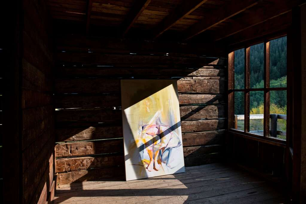 A painting by Denver-based artist Kaitlyn Tucek leans against the wall of a building in the Ashcroft Ghost Town outside of Aspen as part of her two-day exhibition 'The Lilac Hour' outside of Aspen on Friday, Sept. 17, 2021. (Kelsey Brunner/The Aspen Times)