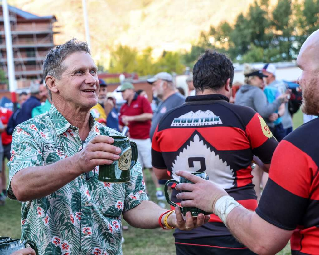 Coach and new Aspen rugby hall of fame member Cameron McIntyre hands out the winning mugs after the Gentlemen of Aspen Rugby Club beat the American Raptors to win Ruggerfest 53 on Sunday, Sept. 26, 2021, on Wagner Park in downtown Aspen. Photo by Austin Colbert/The Aspen Times.