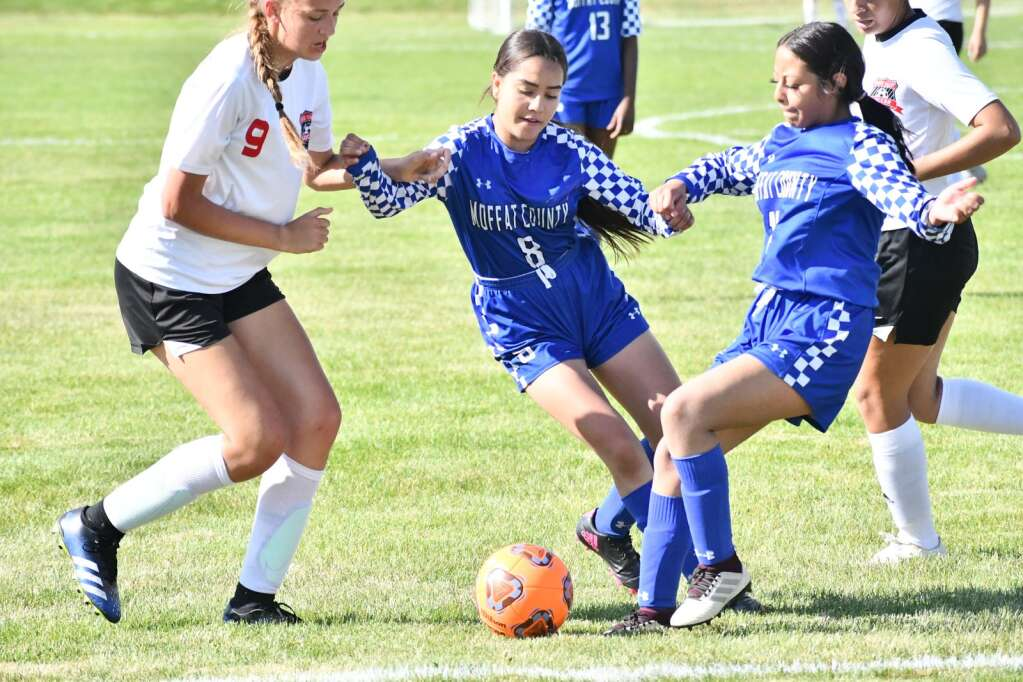 Zicalaly Hernandez, right, and Daniella Yanez, center, skirmish with a Grand Valley player for the ball during Moffat County girls soccer's home finale Thursday in Craig. | Andy Bockelman/For the Craig Press