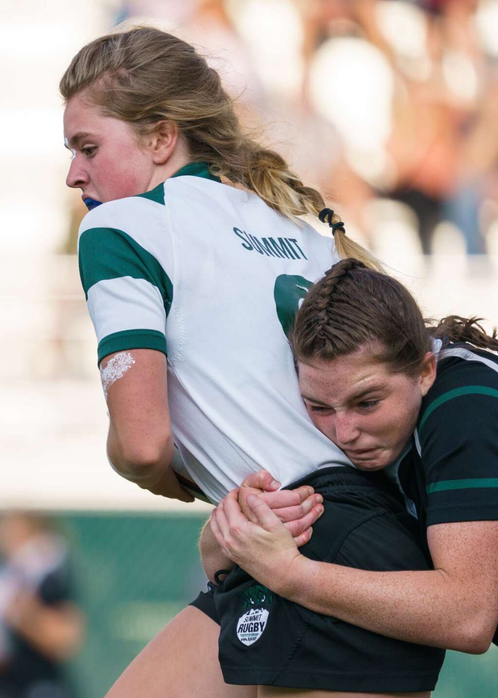 Summit High School sophomore Regan Jackson tackles sophomore Lucia Hoffman during the Green-White rugby scrimmage held at Tiger Stadium in Breckenridge on Thursday, Sept. 2. | John Hanson/For the Summit Daily News