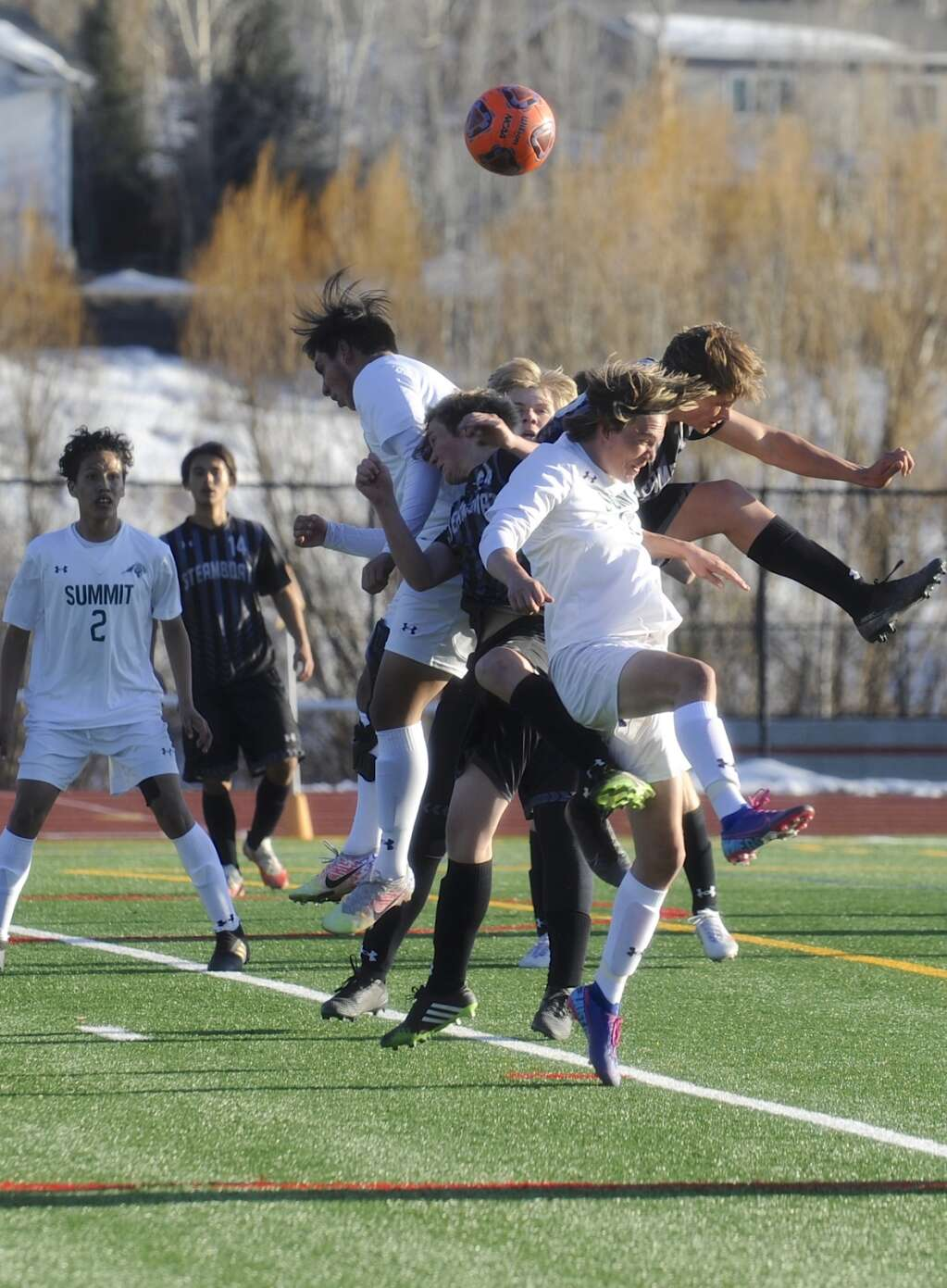 A flurry of heads go up for a ball during a game between Steamboat Springs and Summit at Gardner Field on Wednesday evening. (Photo by Shelby Reardon)