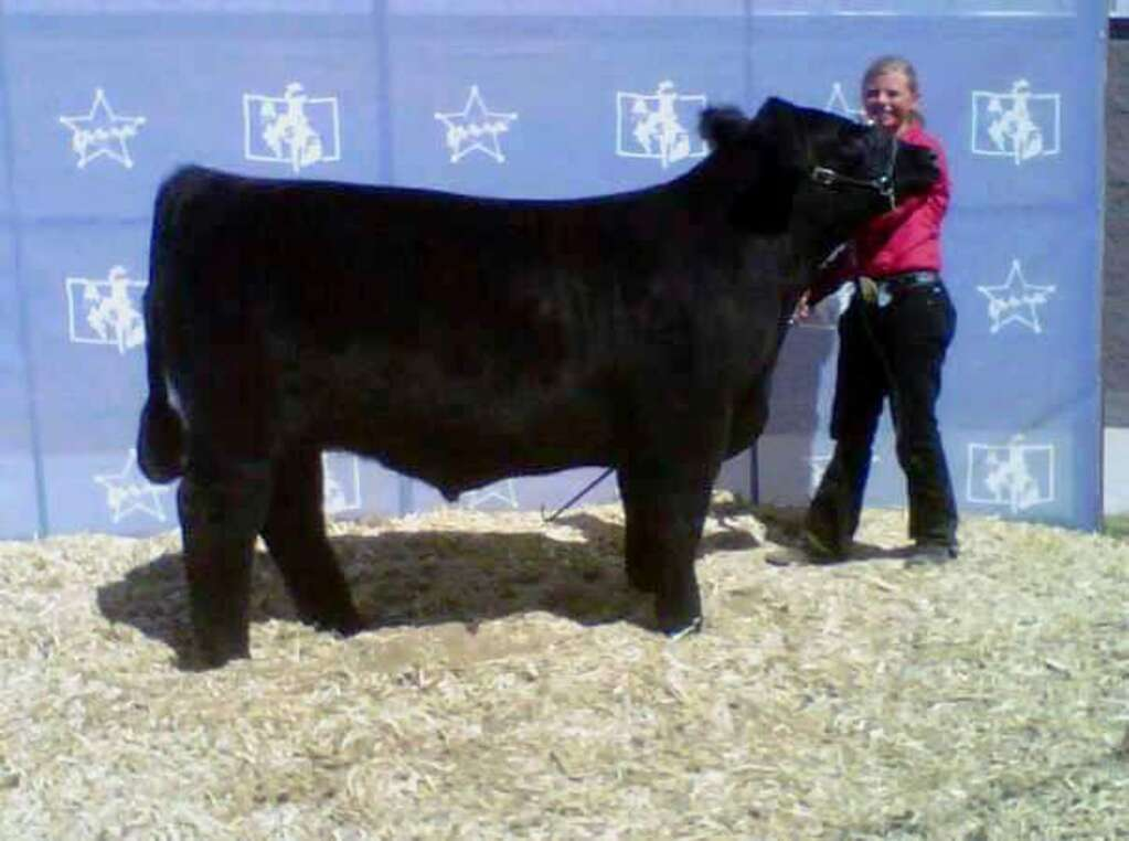 Riley and her steer that won a class at the Wyoming State Fair.