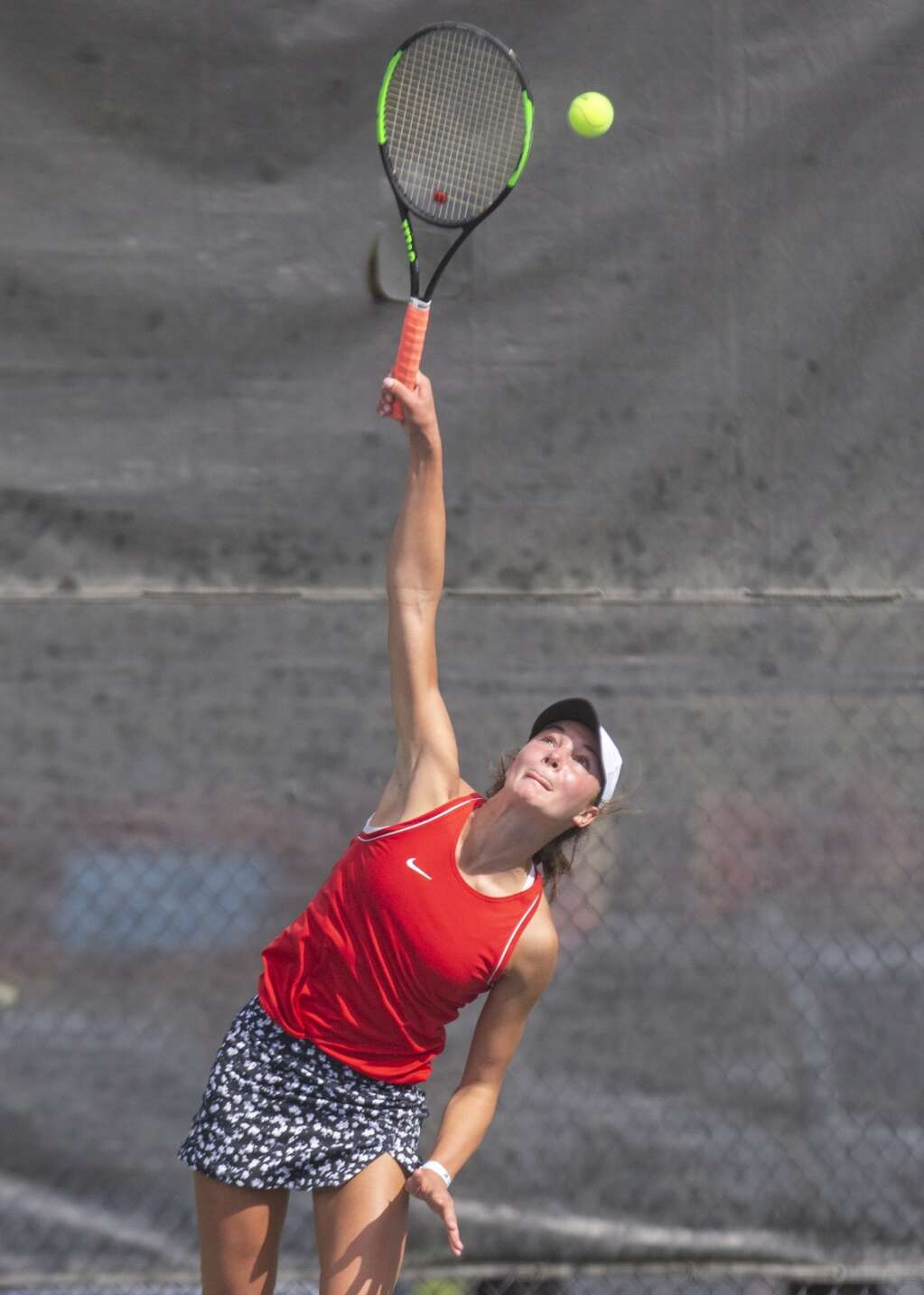 Park City High School's Reagan Harrison serves the ball during her third singles matchup against Provo High School's Sally Otterstrom at the Liberty Park tennis complex as part of the UHSAA 5A girls tennis championships Thursday morning, Oct. 7, 2021. (Tanzi Propst/Park Record)