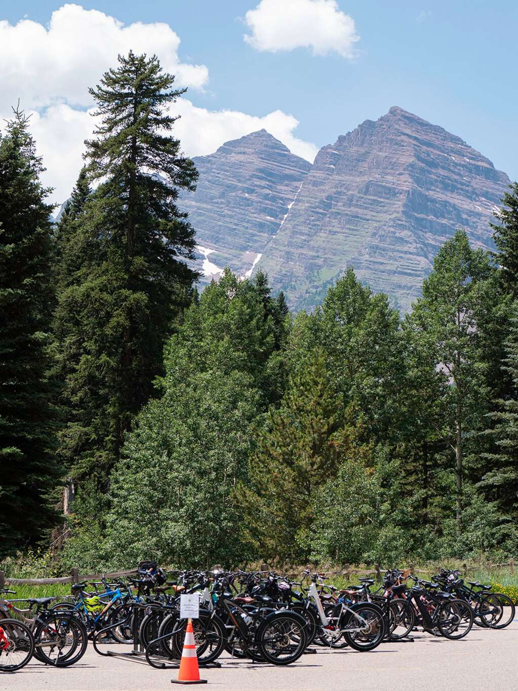E-bikes fill multiple racks in the shadow of the Maroon Bells. An estimated 75% of the bike traffic on Maroon Creek Road is now e-bikes, according to the U.S. Forest Service. | Jim Paussa/Special to The Aspen Times