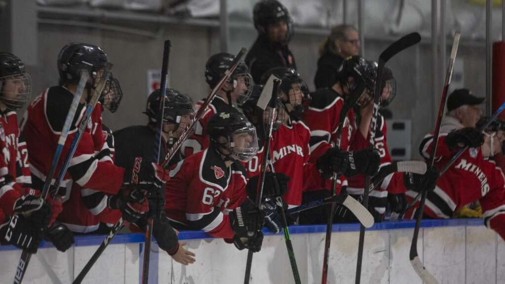 The Park City High School bench celebrates a goal scored against Uintah High School during their matchup at the Park City Ice Arena Saturday evening, Sept. 25, 2021. The Miners defeated the Utes 6-0. (Tanzi Propst/Park Record)