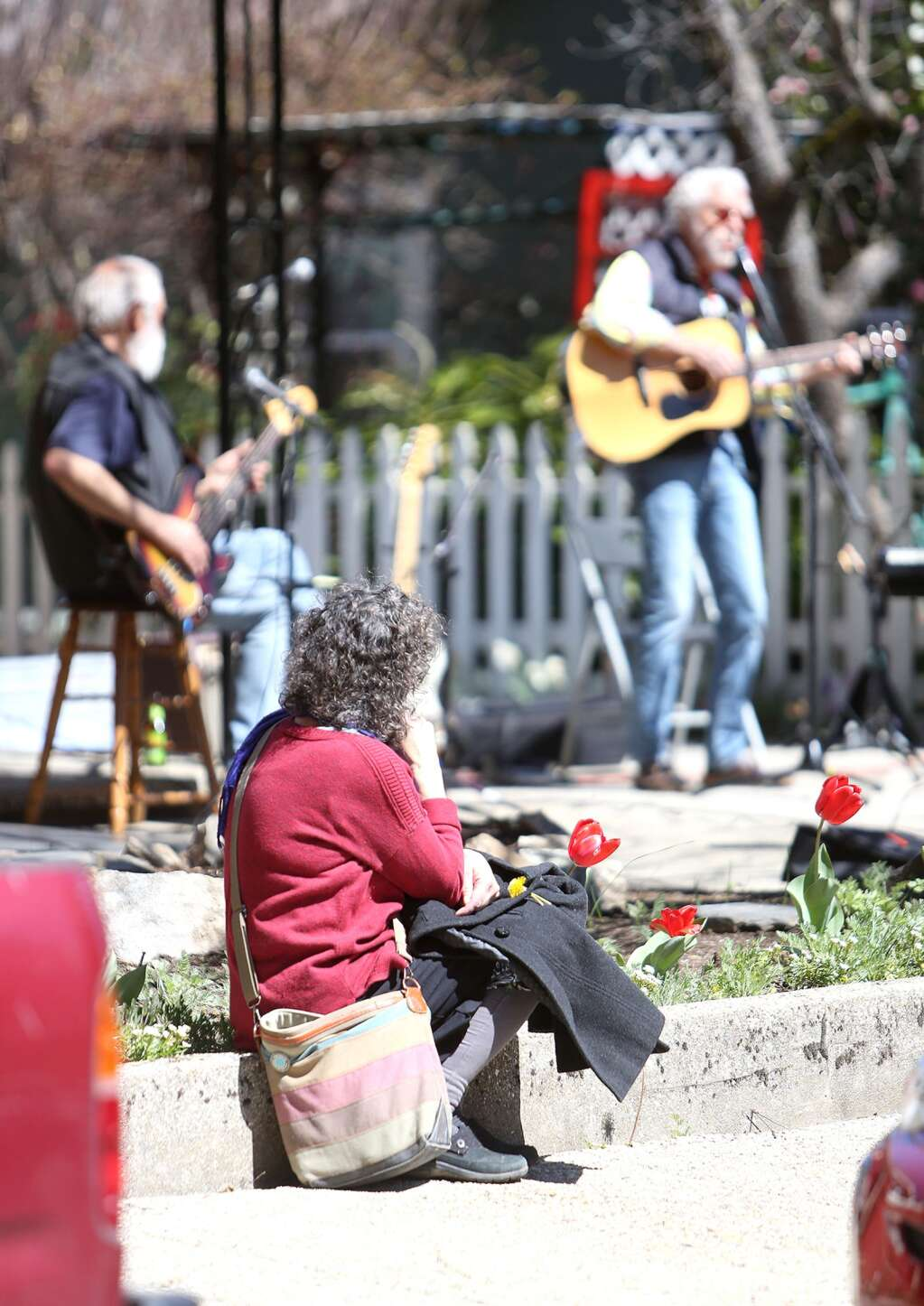 A handful of passersby stopped to take in the live jam session of The Elderly Brothers and friends April 3 in Nevada City. | Photo: Elias Funez