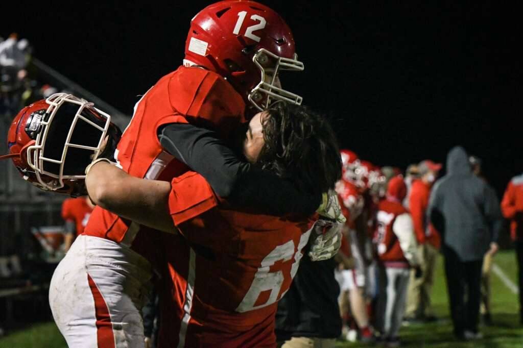 Glenwood Springs Demon Alfonso Angeles and Sebastian Garcia react in the final seconds of the game against the Rifle Bears on Friday night. |Chelsea Self / Post Independent